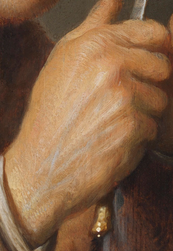Detail of Scholar Sharpening a Quill showing the brushwork of the proper right hand of the scholar