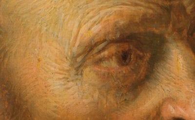 Detail ofHermit Prayingshowing hatching brushwork around the figure's proper right eye